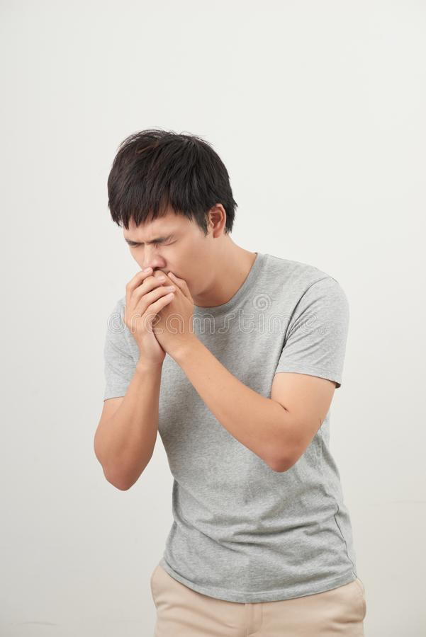 Mature man coughing on white background.  royalty free stock photography