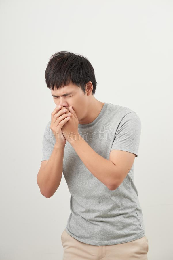 Mature man coughing on white background stock photos