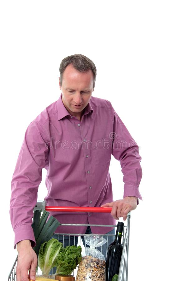 Download Mature Man Doing Grocery Shopping Stock Photos - Image: 24829313