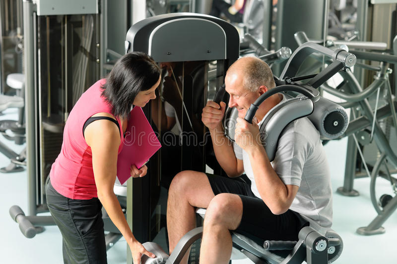 Download Mature Man Exercising With Personal Trainer Stock Photo - Image of explain, instructor: 23410414