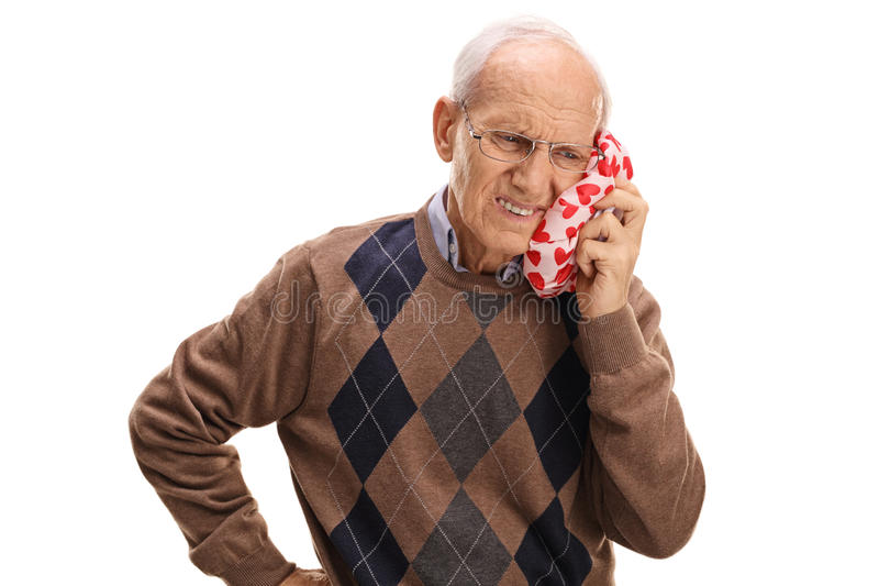 Mature man experiencing a toothache. Isolated on white background stock image
