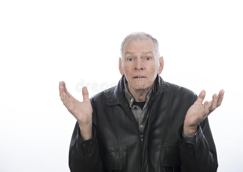 Mature man with hands in the air looking confused stock photos