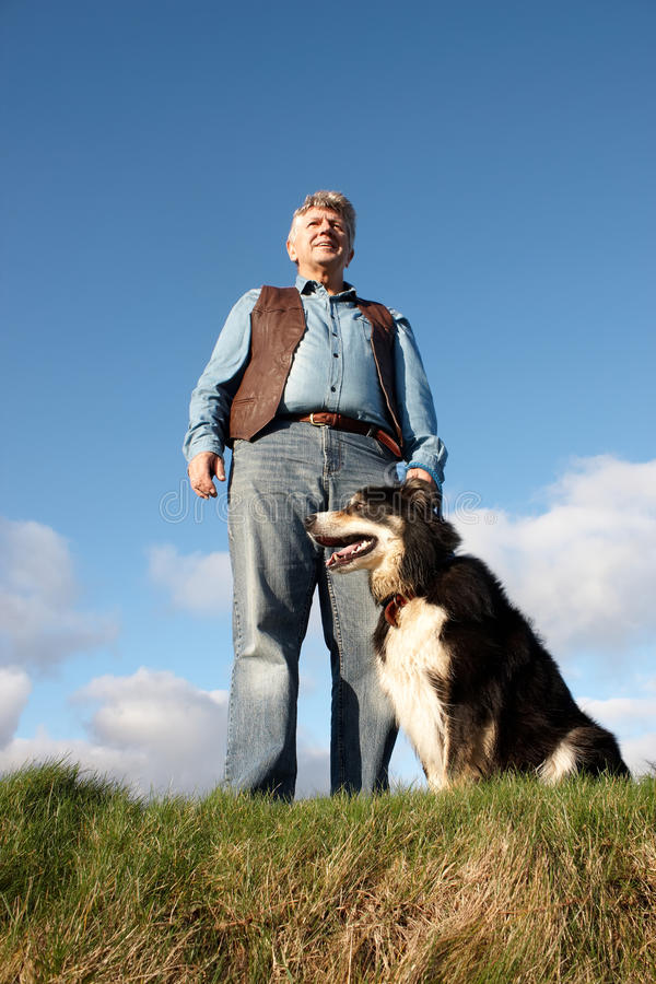Download Mature man and his dog stock image. Image of looking - 25853545