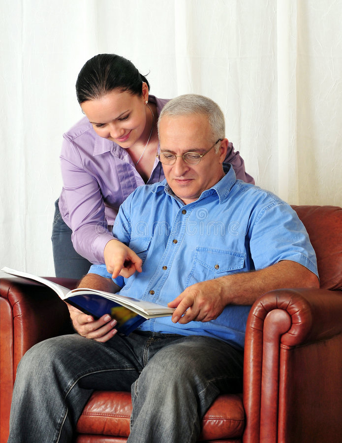 Mature man and his wife reading royalty free stock image