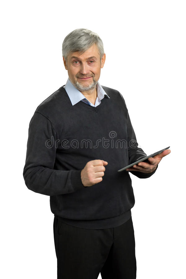Mature man holding computer tablet. stock photo