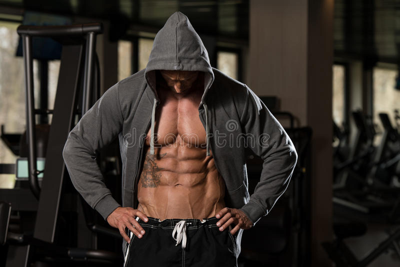 Mature Man In Hoodie Showing His Six Pack royalty free stock photography