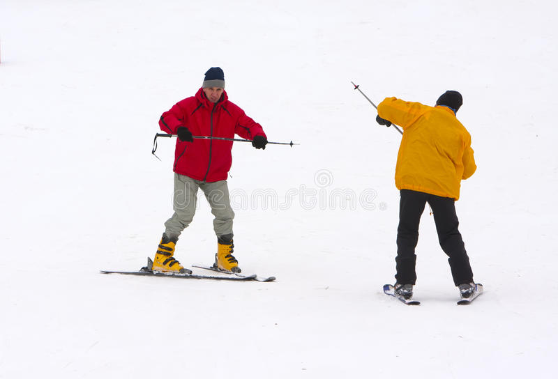 The mature man learns to ride mountain skiing. The mature men learns to ride mountain skiing royalty free stock photography