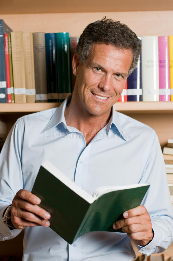 Download Mature man in library stock photo. Image of camera, learn - 9915510