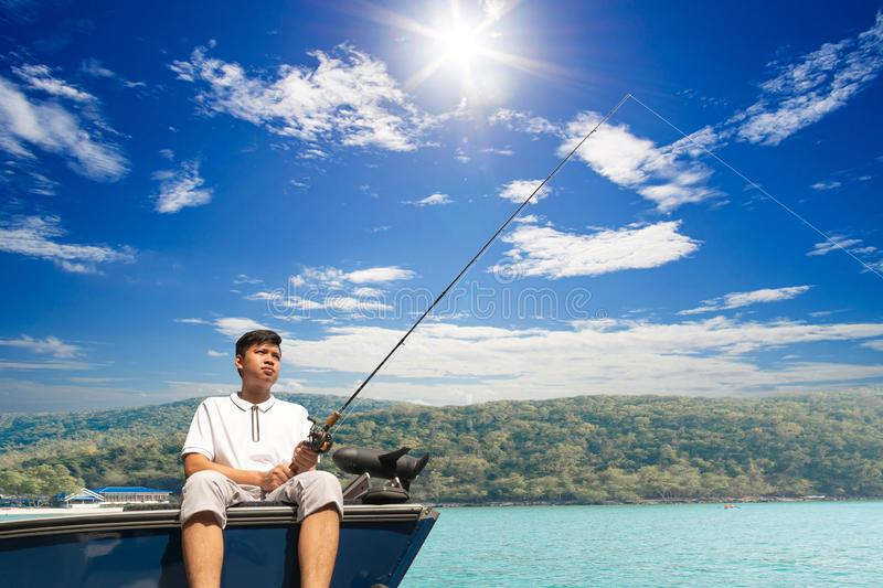 Mature man on a motor boat. Fishing royalty free stock photos