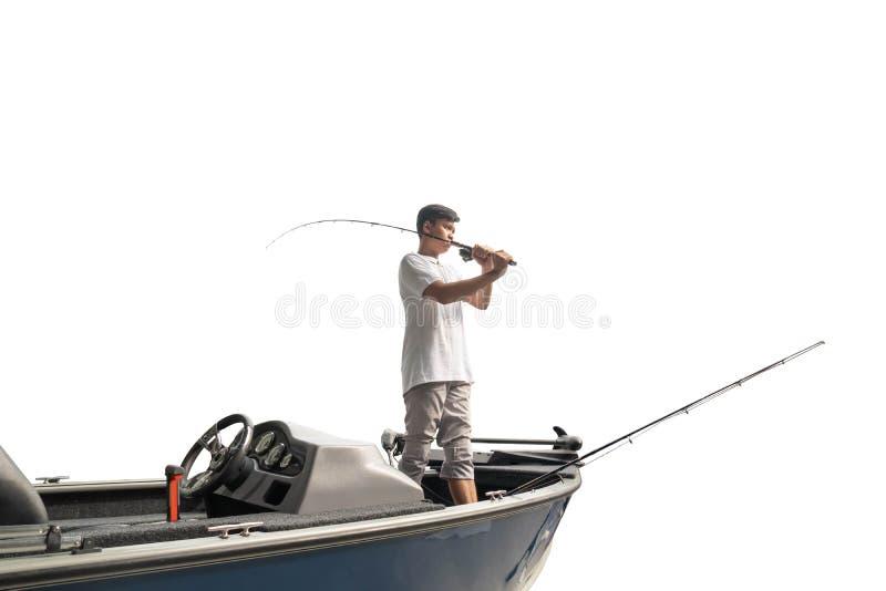 Mature man on a motor boat. Fishing royalty free stock image