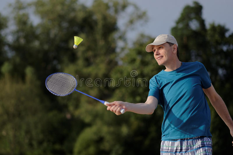 Man playing badminton stock photos