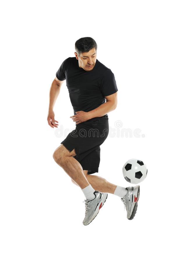 Mature man playing with soccer ball. Isolated on a white background stock photos