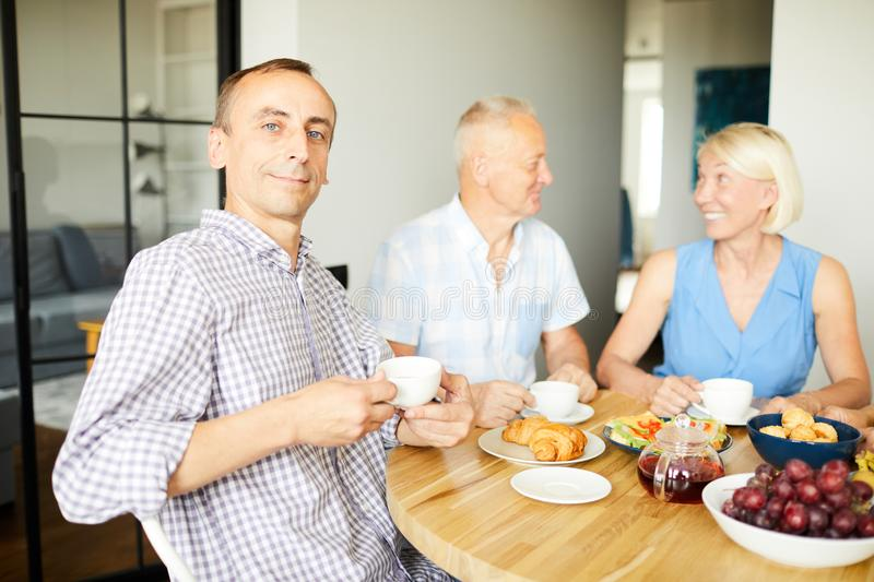 Mature Man Posing at Lunch stock images