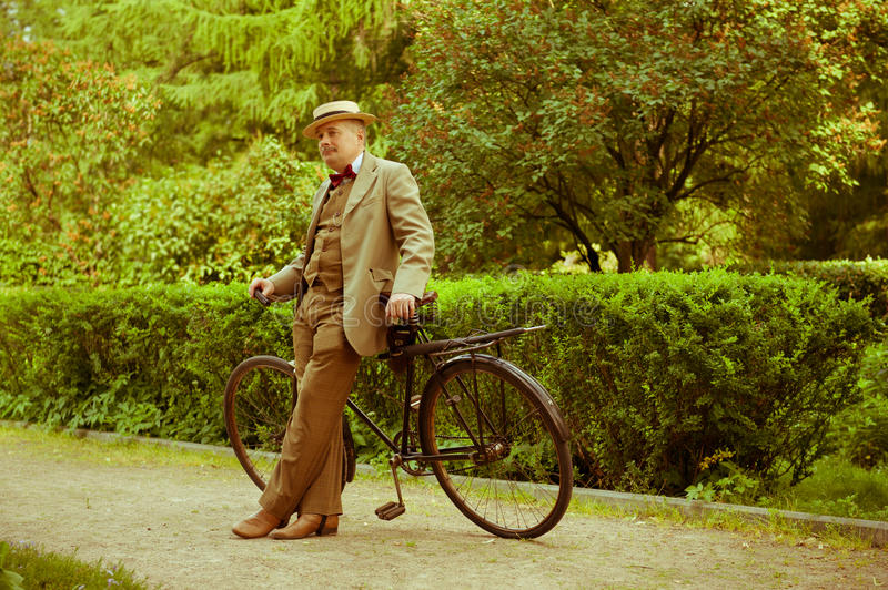 Download Mature Man Posing With Retro Bicycle In The Park Stock Photo - Image: 31576314