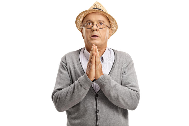 Mature man praying royalty free stock photography