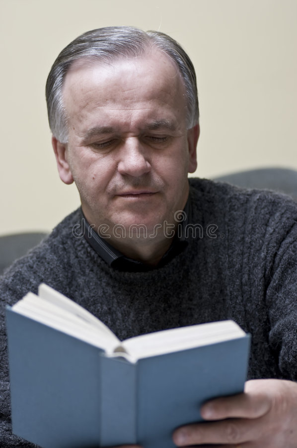 Download Mature man reading book stock image. Image of male, religious - 4724687