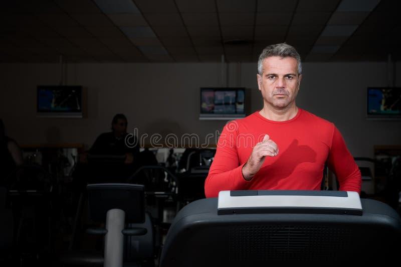Mature man running at gym stock photos