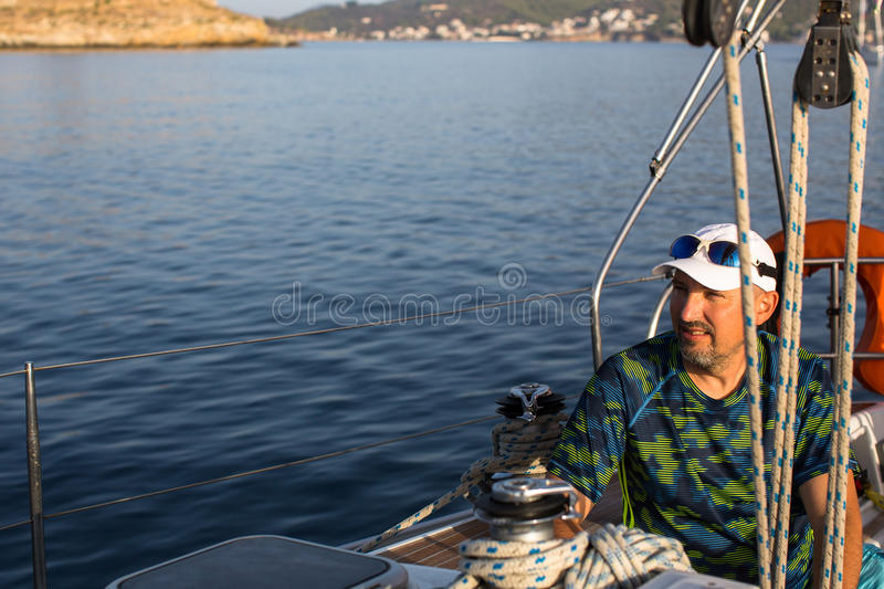 Mature man on sailing yacht boat in the sea. Sport. stock photos