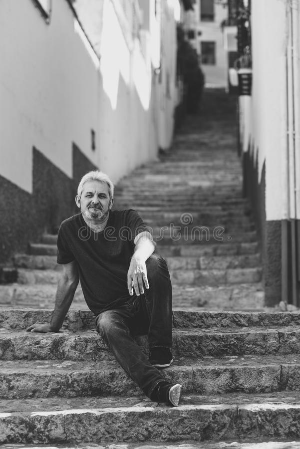 Free Mature Man Sitting On Steps In Urban Background Royalty Free Stock Images - 102739759