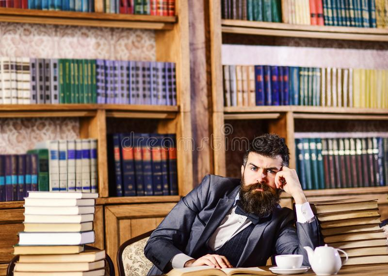 Mature man in smart suit thinks about literature. royalty free stock photo