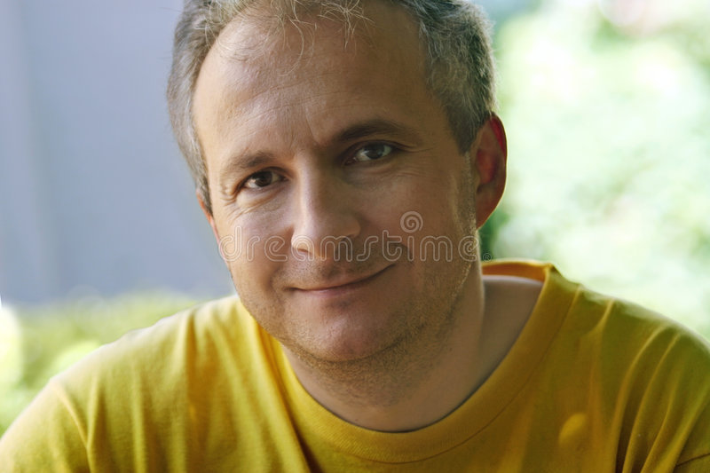 Mature man smiling stock photo