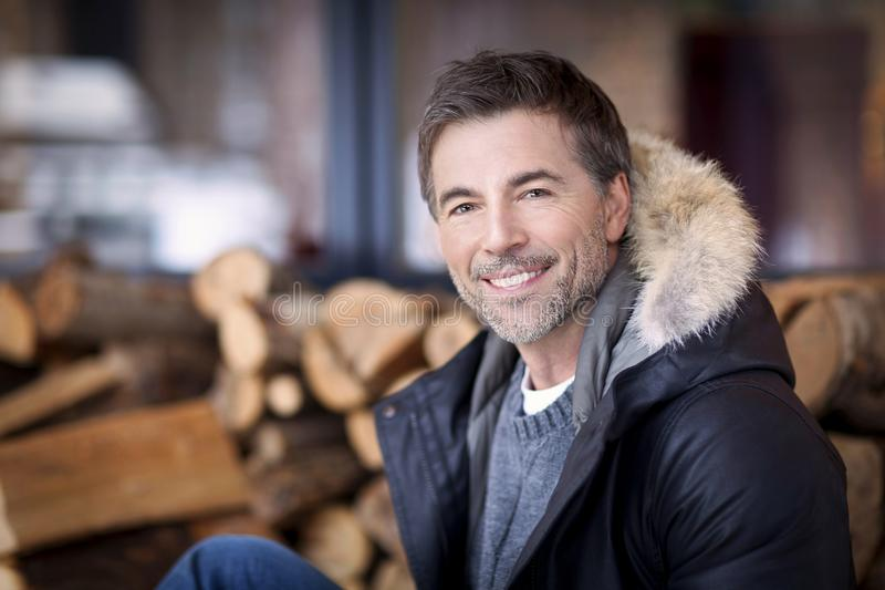 Mature man smiling at the camera. At the country house stock image
