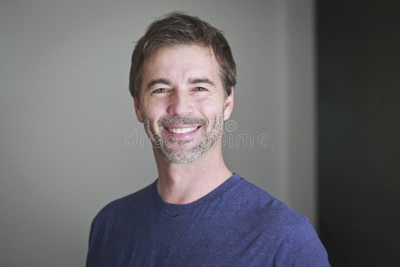 Mature Man Smiling At The Camera stock images
