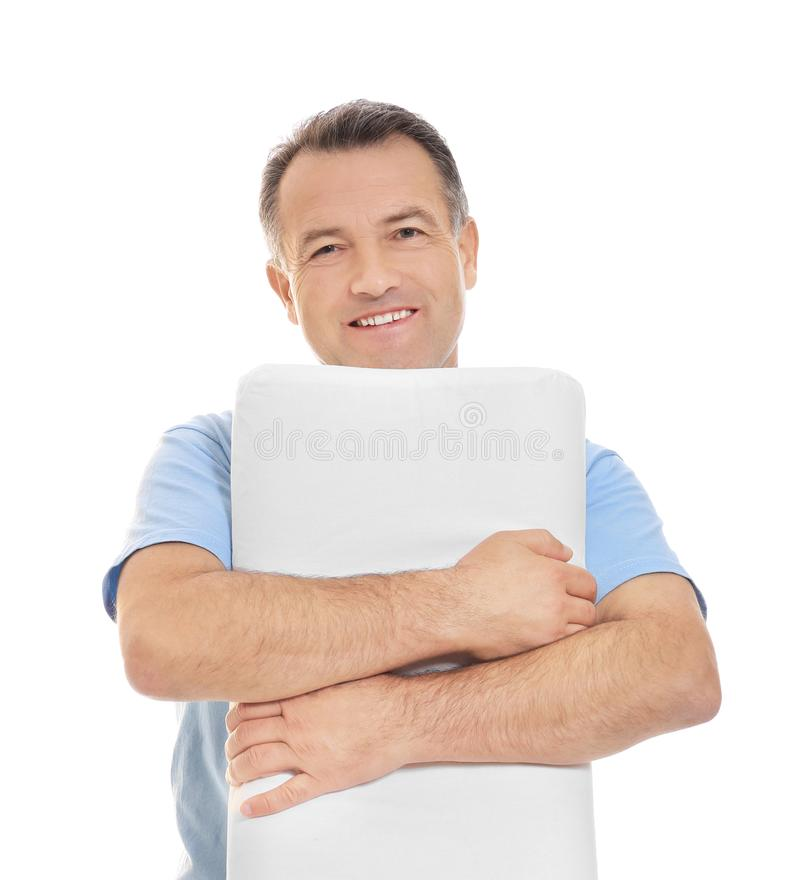 Mature man with soft pillow. On white background royalty free stock photo