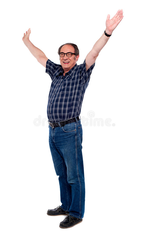 Mature man standing with open arms royalty free stock photos