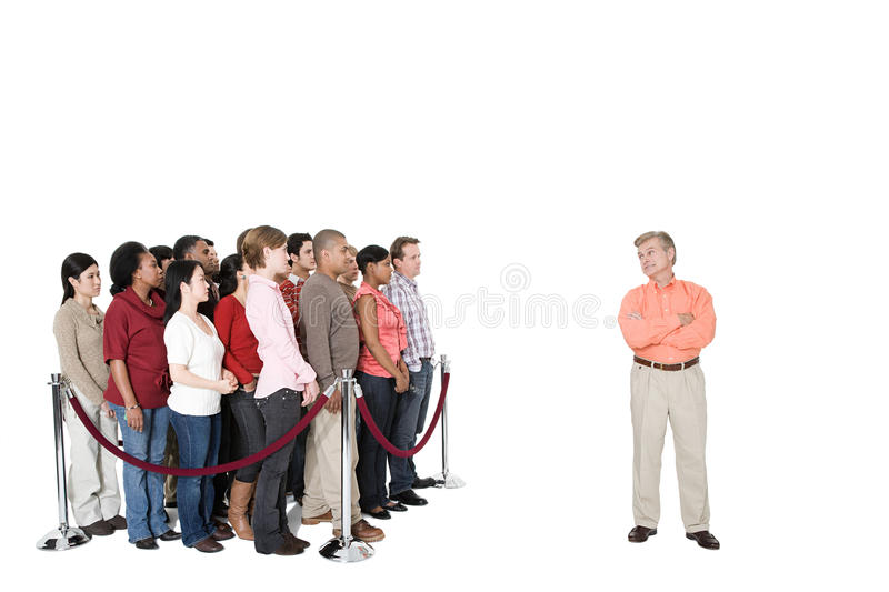 A mature man standing out from the crowd stock photos