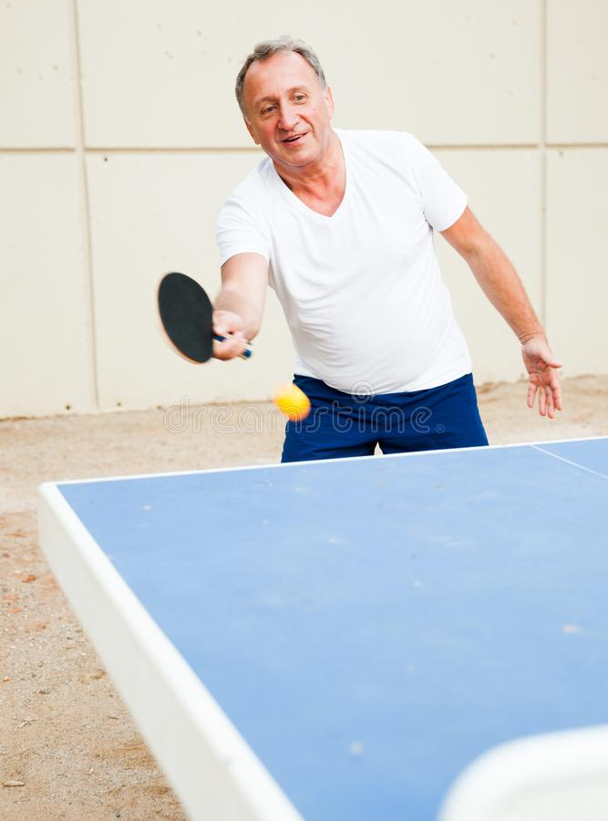 Free Mature Man Starts A Party At Ping Pong At Outdoor Royalty Free Stock Photo - 161041255