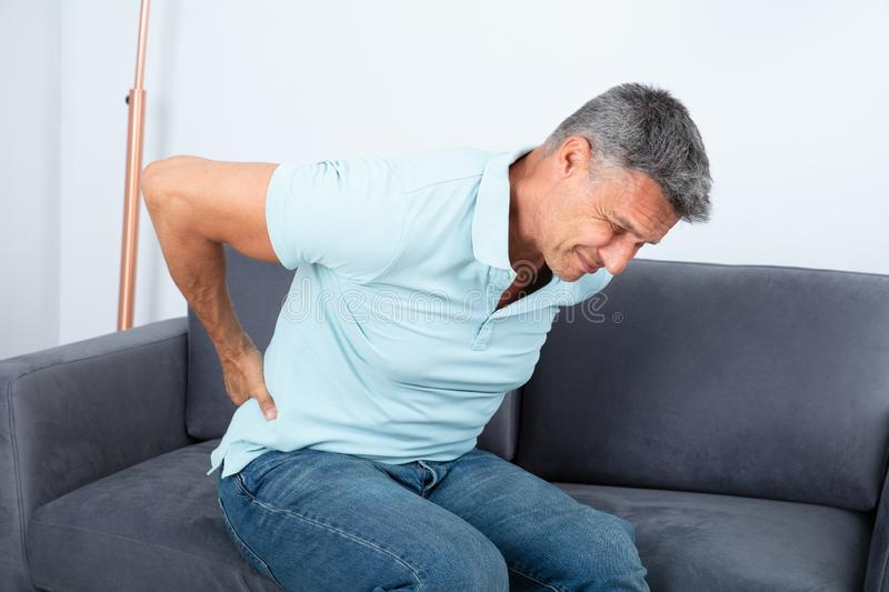 Mature Man Suffering From Back Pain royalty free stock photos