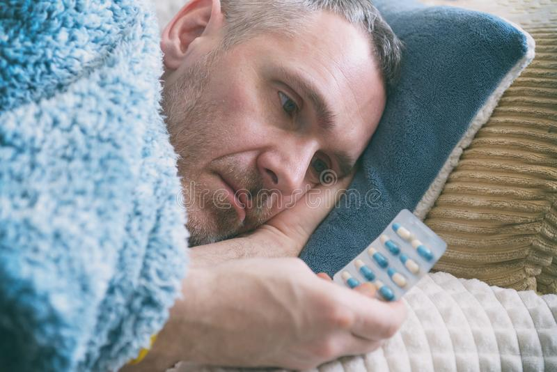 Mature man suffering from depression stock photos
