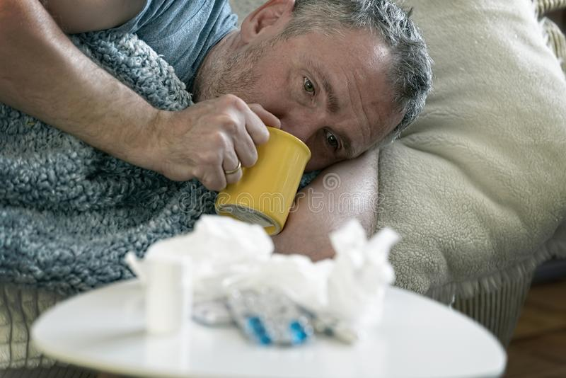 Mature man suffering from flu or cold royalty free stock image
