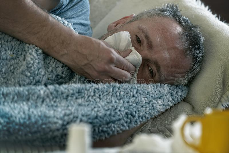 Mature man suffering from flu or cold royalty free stock images