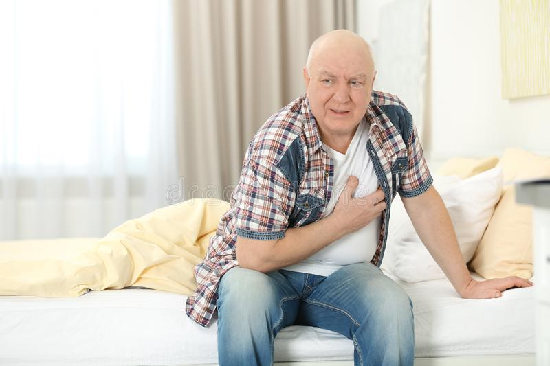 Mature man suffering from pain royalty free stock images