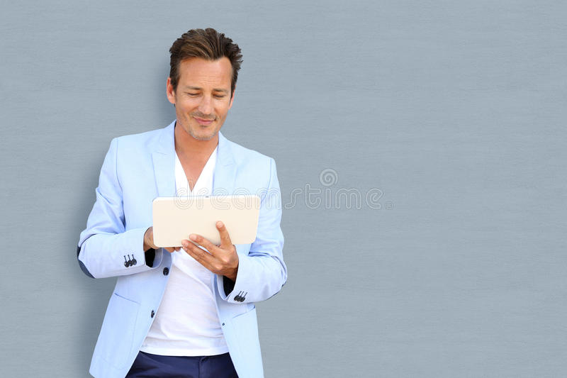 Mature man with tablet royalty free stock photography