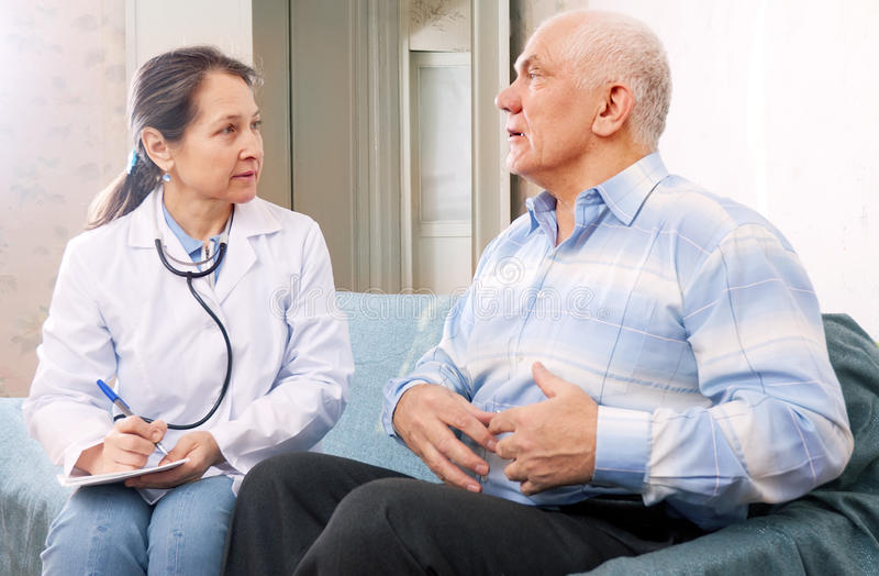 Mature man tells the doctor the symptoms stock image