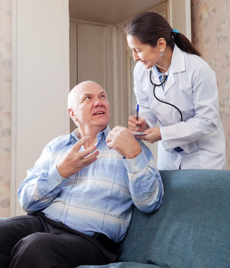 Mature man tells the doctor the symptoms royalty free stock image