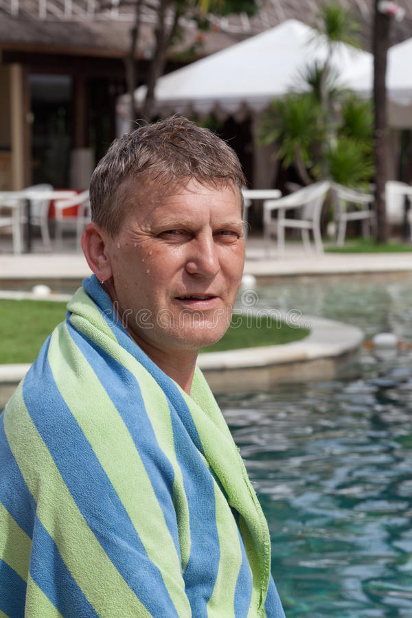 Mature man in a towel stock photography