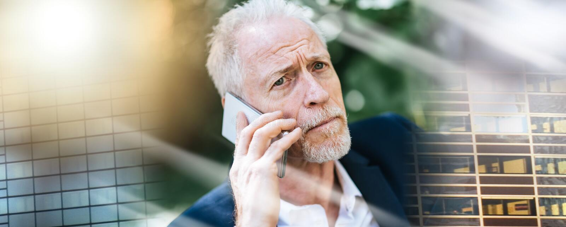 Mature man using his mobile phone, light effect; multiple exposure stock photos