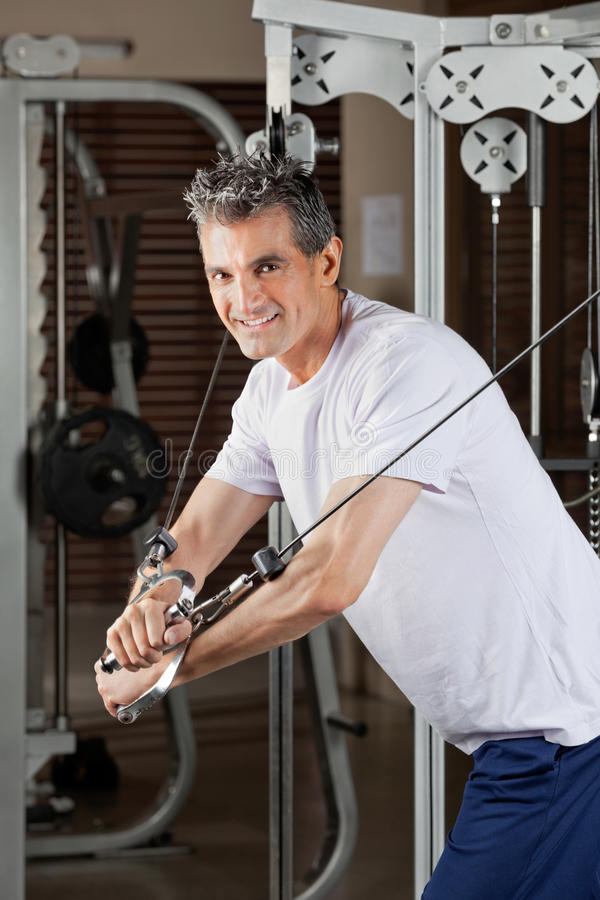 Mature Man Working Out In Fitness Center stock photography