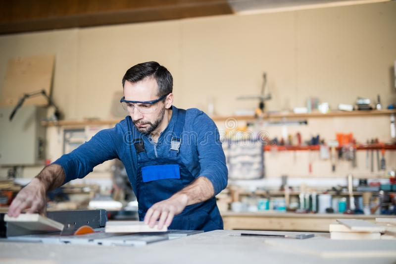 Mature Man Working with Wood royalty free stock photos