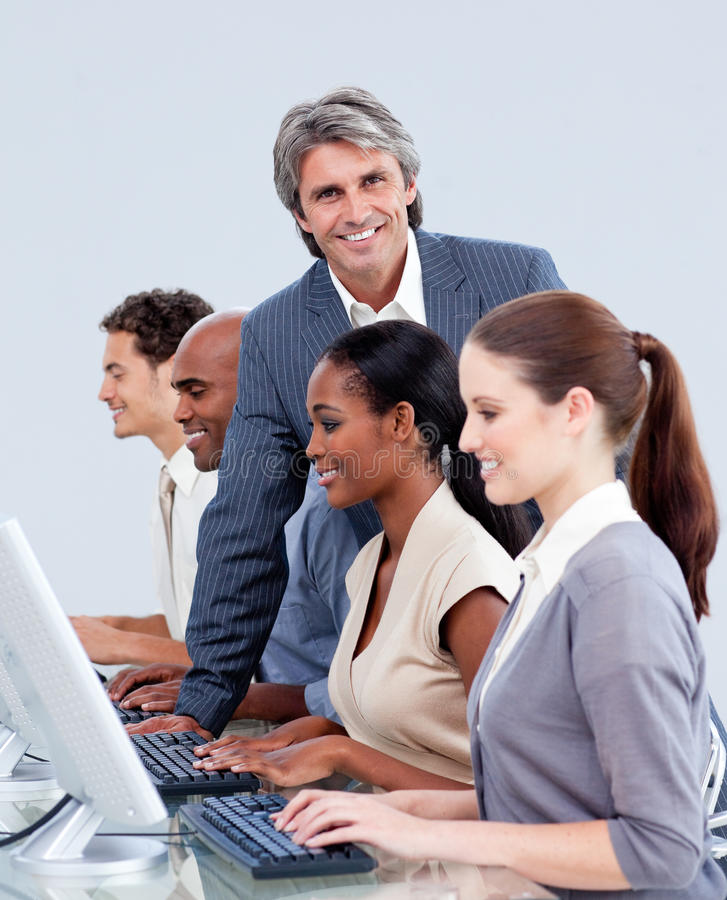 Download Mature Manager Checking His Team's Work Stock Image - Image: 12975123