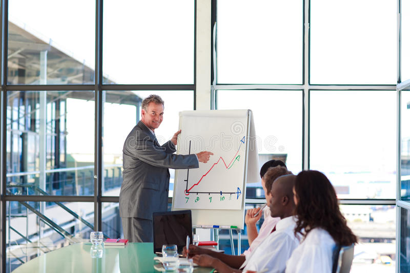 Mature Manager Explaining A New Plan To H Stock Image
