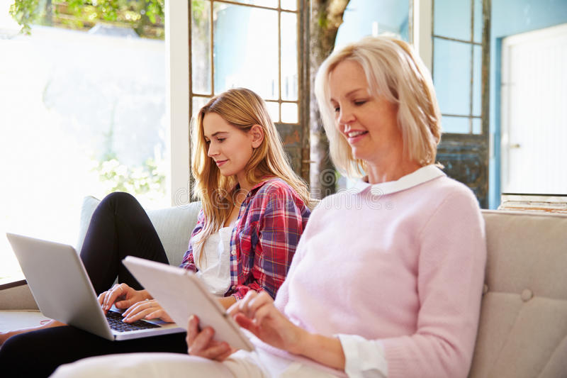 Mature Mother With Adult Daughter Using Digital Devices royalty free stock photo