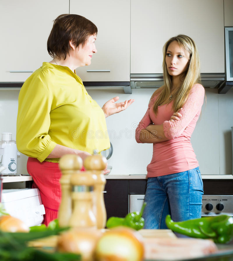 Mature mother with daughter having serious conversation royalty free stock image