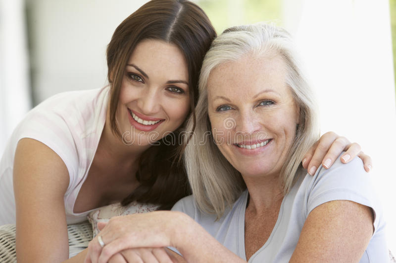 Mature Mother And Daughter Hugging royalty free stock photos