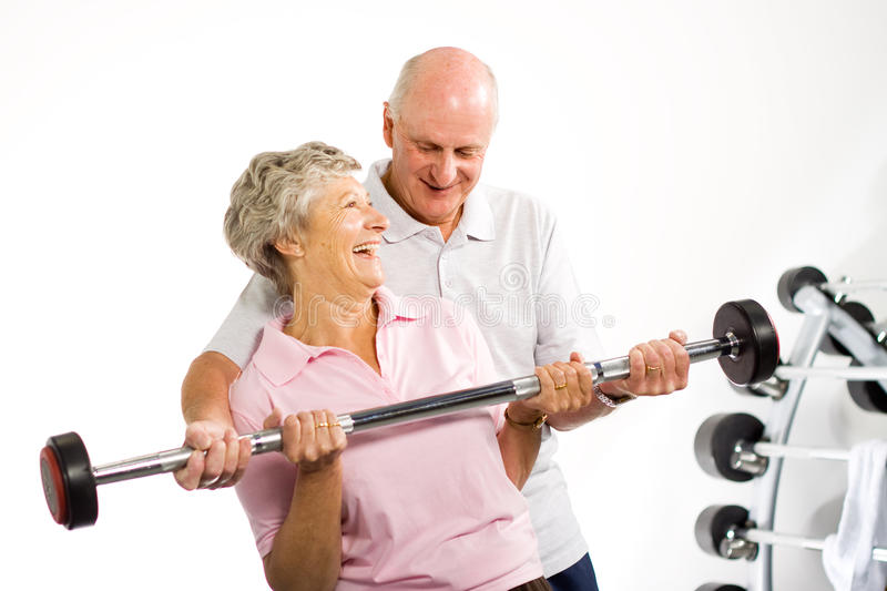 Download Mature Older Couple Lifting Weights Stock Image - Image: 10472761
