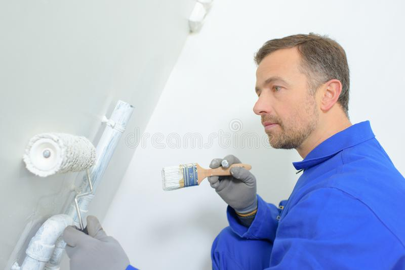 Mature painter working at clients site royalty free stock photos